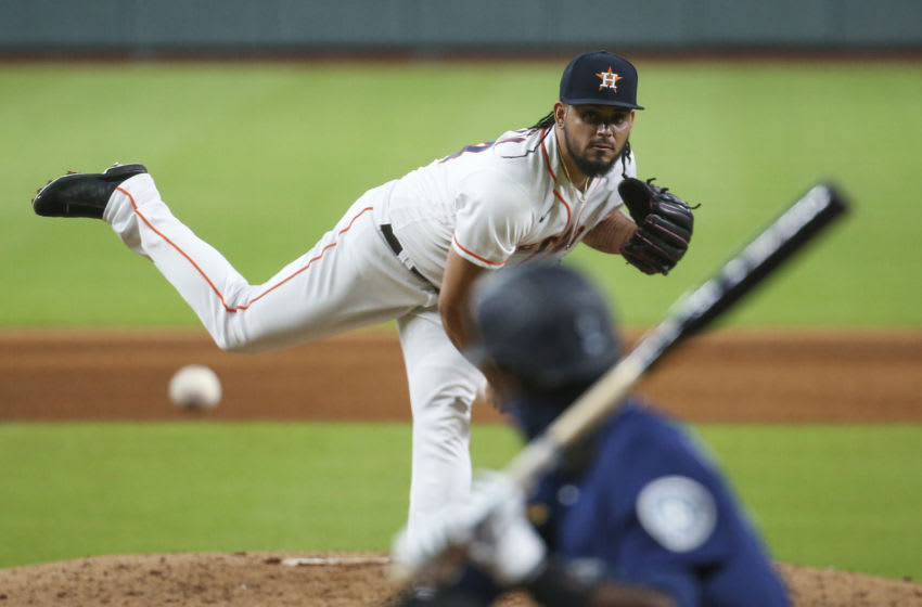 Jul 25, 2020; Houston, Texas, USA; Houston Astros relief pitcher Roberto Osuna (54) delivers a pitch during the ninth inning against the Seattle Mariners at Minute Maid Park. Mandatory Credit: Troy Taormina-USA TODAY Sports