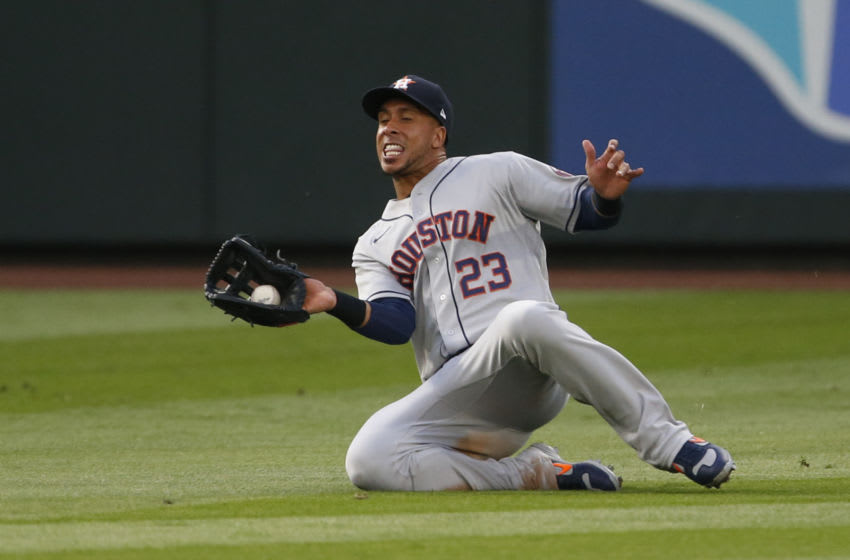 Sep 21, 2020; Seattle, Washington, USA; Houston Astros left fielder Michael Brantley (23) catches a fly ball for an out against the Seattle Mariners during the second inning at T-Mobile Park. Mandatory Credit: Joe Nicholson-USA TODAY Sports