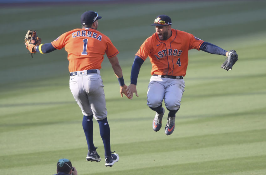 Oct 5, 2020; Los Angeles, California, USA; Houston Astros shortstop Carlos Correa (1) and center fielder George Springer (4) celebrate after game one of the 2020 ALDS against the Oakland Athletics at Dodger Stadium. Mandatory Credit: Jayne Kamin-Oncea-USA TODAY Sports