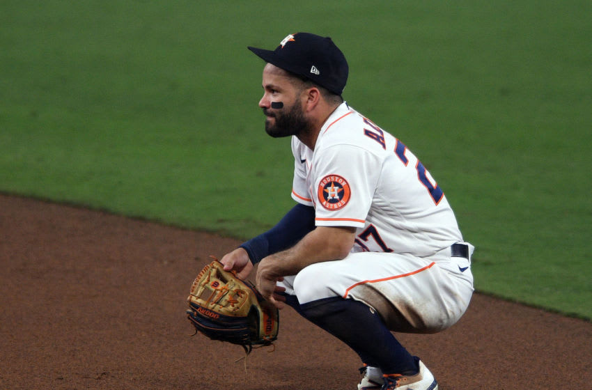 Oct 13, 2020; San Diego, California, USA; Houston Astros second baseman Jose Altuve (27) reacts after committing an error against the Tampa Bay Rays during the sixth inning in game three of the 2020 ALCS at Petco Park. Mandatory Credit: Orlando Ramirez-USA TODAY Sports