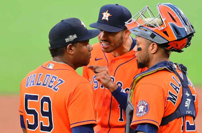Oct 16, 2020; San Diego, California, USA; Houston Astros shortstop Carlos Correa (1) talks to starting pitcher Framber Valdez (59) following an altercation after he walked Tampa Bay Rays first baseman Yandy Diaz (not pictured) during the sixth inning during game six of the 2020 ALCS at Petco Park. Mandatory Credit: Jayne Kamin-Oncea-USA TODAY Sports
