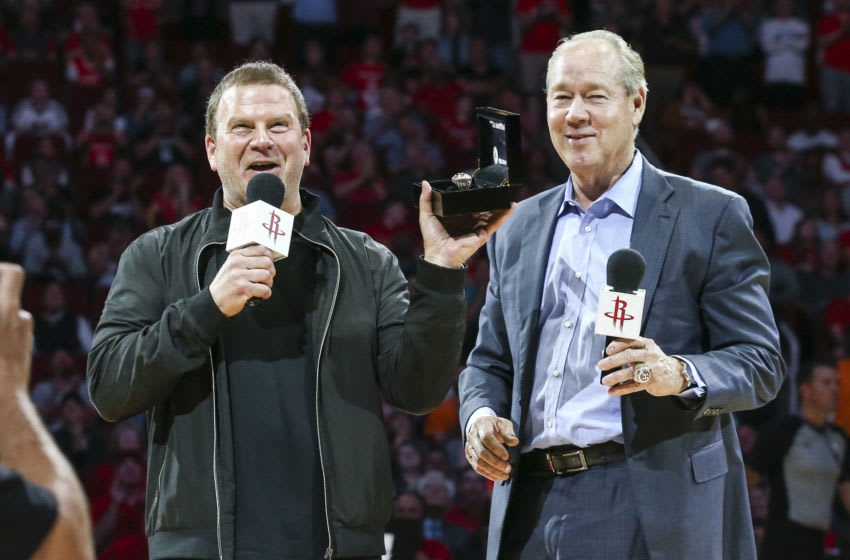 Apr 5, 2018; Houston, TX, USA; Houston Astros owner Jim Crane (right) presents Houston Rockets owner Tilman Fertitta (left) with a world series championship ring during the game against the Portland Trail Blazers at Toyota Center. Mandatory Credit: Troy Taormina-USA TODAY Sports