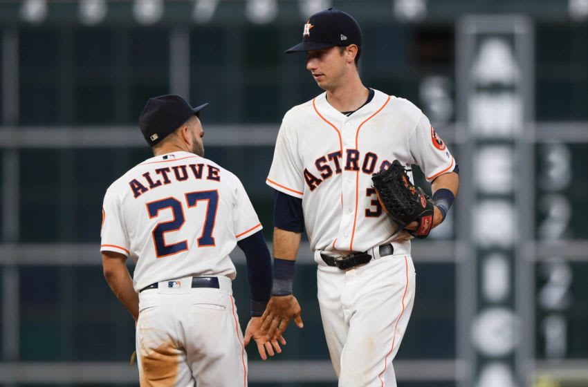 Jose Altuve (27) and right fielder Kyle Tucker (3) celebrate the win over the Chicago White Sox at Minute Maid Park. Mandatory Credit: Shanna Lockwood-USA TODAY Sports