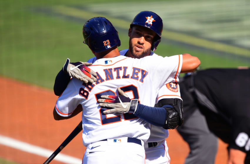 George Springer (4) celebrates with left fielder Michael Brantley (23) after hitting a solo home run against the Tampa Bay Rays in the first inning during game five of the 2020 ALCS at Petco Park. Mandatory Credit: Jayne Kamin-Oncea-USA TODAY Sports