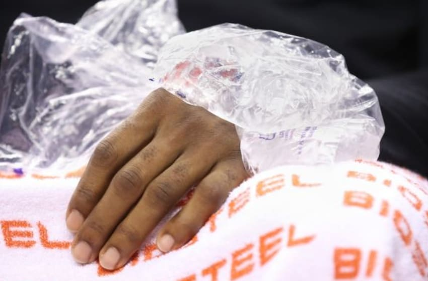 Nov 25, 2015; Toronto, Ontario, CAN; Cleveland Cavaliers forward LeBron James (23) puts an ice pack on his hand as he sits on the bench against the Toronto Raptors at Air Canada Centre. The Raptors beat the Cavaliers 103-99. Mandatory Credit: Tom Szczerbowski-USA TODAY Sports