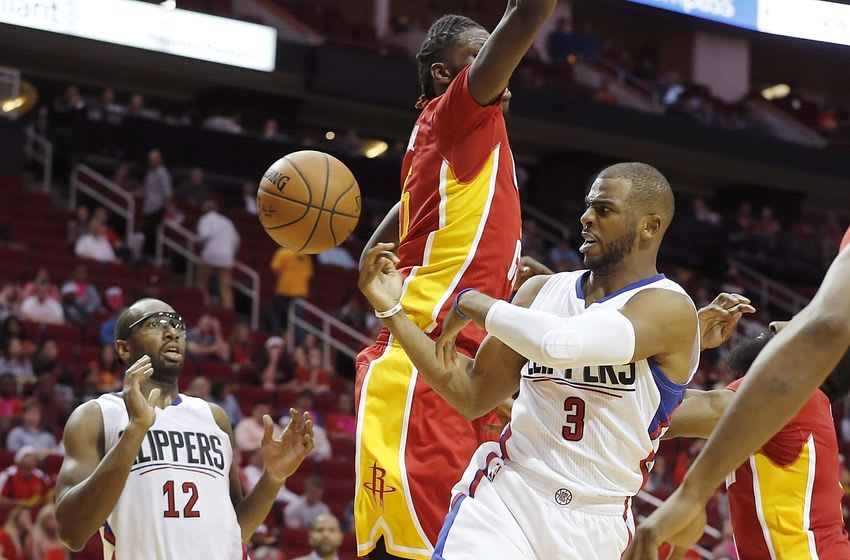 Mar 16, 2016; Houston, TX, USA; Los Angeles Clippers guard Chris Paul (3) makes a pass to forward Luc Richard Mbah a Moute (12) against Houston Rockets forward Montrezl Harrell (35) in the second half at Toyota Center. The Clippers won 122-106. Mandatory Credit: Thomas B. Shea-USA TODAY Sports