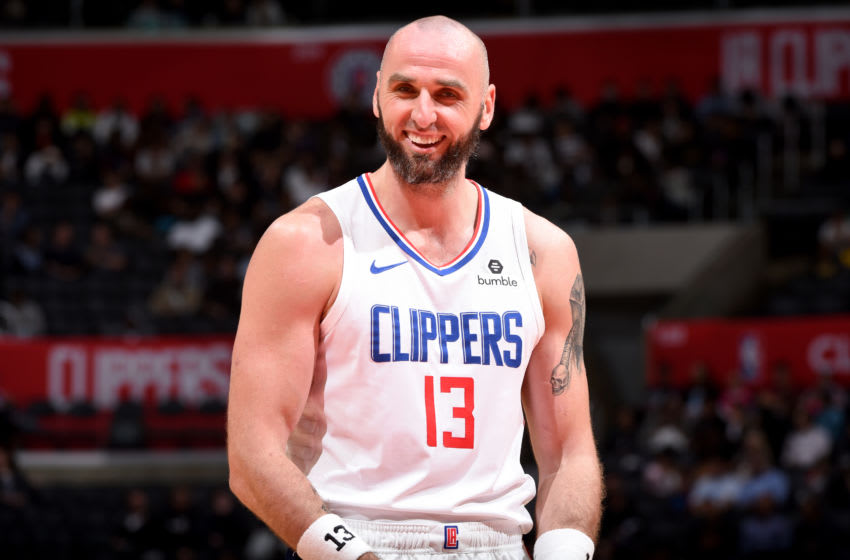 LOS ANGELES, CA - OCTOBER 11: Marcin Gortat #13 of the LA Clippers reacts during a pre-season game against the Maccabi Haifa on October 11, 2018 at Staples Center, in Los Angeles, California. NOTE TO USER: User expressly acknowledges and agrees that, by downloading and/or using this Photograph, user is consenting to the terms and conditions of the Getty Images License Agreement. Mandatory Copyright Notice: Copyright 2018 NBAE (Photo by Adam Pantozzi/NBAE via Getty Images)