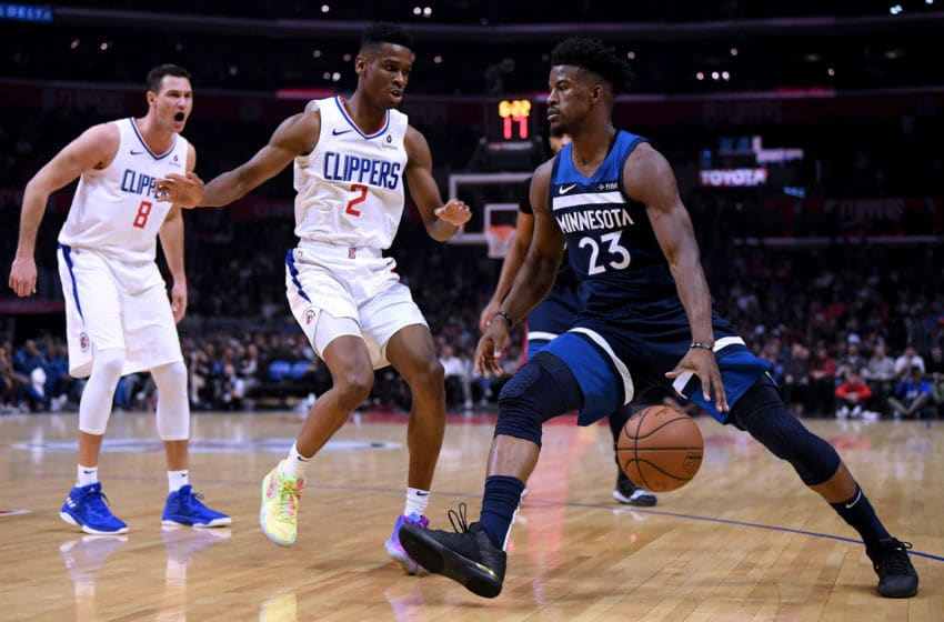 LOS ANGELES, CA - NOVEMBER 05: Jimmy Butler #23 of the Minnesota Timberwolves drives on Shai Gilgeous-Alexander #2 and Danilo Gallinari #8 of the LA Clippers at Staples Center on November 5, 2018 in Los Angeles, California. (Photo by Harry How/Getty Images)