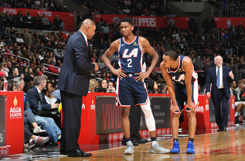 LOS ANGELES, CA - DECEMBER 29: Head Coach Doc Rivers talks to Shai Gilgeous-Alexander #2 and Avery Bradley #11 of the LA Clippers during the game against the San Antonio Spurs on December 29, 2018 at STAPLES Center in Los Angeles, California. NOTE TO USER: User expressly acknowledges and agrees that, by downloading and/or using this photograph, user is consenting to the terms and conditions of the Getty Images License Agreement. Mandatory Copyright Notice: Copyright 2018 NBAE (Photo by Andrew D. Bernstein/NBAE via Getty Images)
