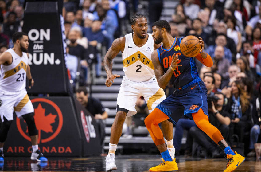 TORONTO, CANADA - MARCH 22: Paul George #13 of the Oklahoma City Thunder handles the ball against Kawhi Leonard #2 of the Toronto Raptors on March 22, 2019 at Scotiabank Arena in Toronto, Ontario, Canada. NOTE TO USER: User expressly acknowledges and agrees that, by downloading and/or using this photograph, user is consenting to the terms and conditions of the Getty Images License Agreement. Mandatory Copyright Notice: Copyright 2019 NBAE (Photo by Zach Beeker/NBAE via Getty Images)