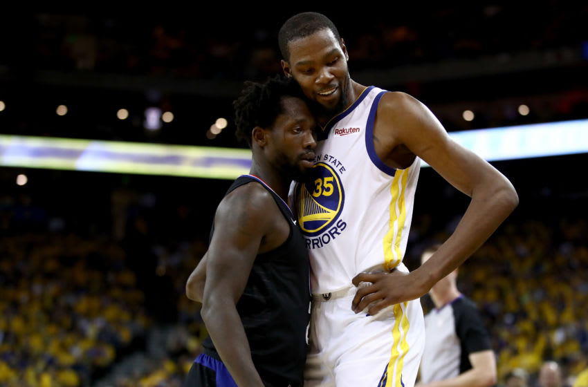 OAKLAND, CALIFORNIA - APRIL 13: Patrick Beverley #21 of the LA Clippers plays tight defense on Kevin Durant #35 of the Golden State Warriors during Game One of the first round of the 2019 NBA Western Conference Playoffs at ORACLE Arena on April 13, 2019 in Oakland, California. Both players were ejected later in the game. NOTE TO USER: User expressly acknowledges and agrees that, by downloading and or using this photograph, User is consenting to the terms and conditions of the Getty Images License Agreement. (Photo by Ezra Shaw/Getty Images)