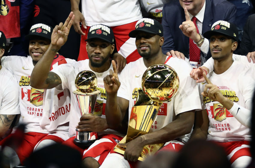 OAKLAND, CALIFORNIA - JUNE 13: Kawhi Leonard #2 and Serge Ibaka #9 of the Toronto Raptors celebrates their teams victory over the Golden State Warriors in Game Six to win the 2019 NBA Finals at ORACLE Arena on June 13, 2019 in Oakland, California. NOTE TO USER: User expressly acknowledges and agrees that, by downloading and or using this photograph, User is consenting to the terms and conditions of the Getty Images License Agreement. (Photo by Ezra Shaw/Getty Images)