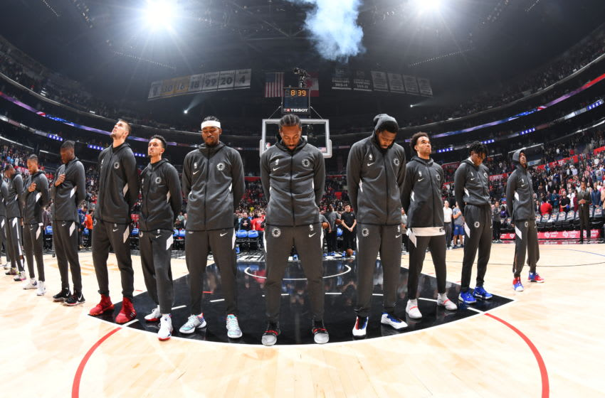 LOS ANGELES, CA - NOVEMBER 11: The LA Clippers stand for the National Anthem prior to the game against the Toronto Raptors on November 11, 2019 at STAPLES Center in Los Angeles, California. NOTE TO USER: User expressly acknowledges and agrees that, by downloading and/or using this Photograph, user is consenting to the terms and conditions of the Getty Images License Agreement. Mandatory Copyright Notice: Copyright 2019 NBAE (Photo by Adam Pantozzi/NBAE via Getty Images)