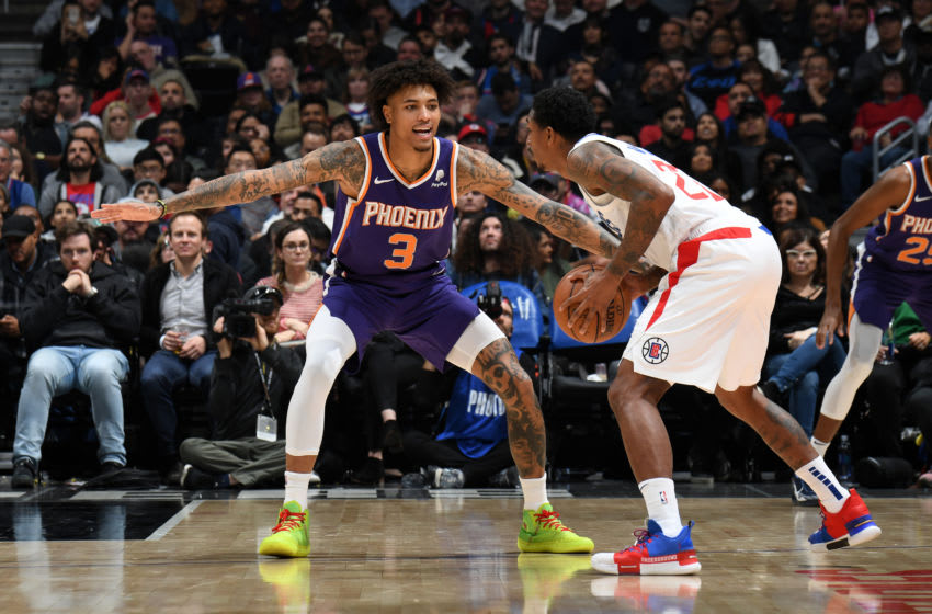 LOS ANGELES, CA - DECEMBER 17: Kelly Oubre Jr. #3 of the Phoenix Suns plays defense against the LA Clippers on December 17, 2019 at STAPLES Center in Los Angeles, California. NOTE TO USER: User expressly acknowledges and agrees that, by downloading and/or using this Photograph, user is consenting to the terms and conditions of the Getty Images License Agreement. Mandatory Copyright Notice: Copyright 2019 NBAE (Photo by Andrew D. Bernstein/NBAE via Getty Images)