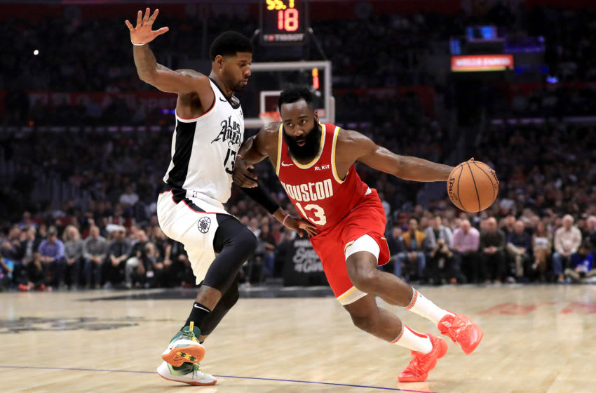LOS ANGELES, CALIFORNIA - NOVEMBER 22: James Harden #13 of the Houston Rockets dribbles past Paul George #13 of the Los Angeles Clippers during the first half of a game at Staples Center on November 22, 2019 in Los Angeles, California. NOTE TO USER: User expressly acknowledges and agrees that, by downloading and/or using this photograph, user is consenting to the terms and conditions of the Getty Images License Agreement (Photo by Sean M. Haffey/Getty Images)