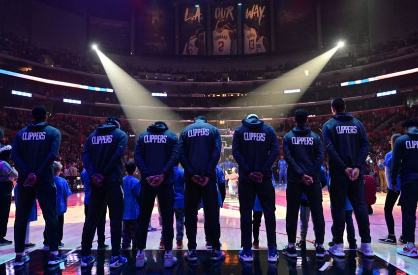 LOS ANGELES, CA - JANUARY 05: The LA Clippers line up for the National Anthem before playing the New York Knicks at Staples Center on January 5, 2020 in Los Angeles, California. NOTE TO USER: User expressly acknowledges and agrees that, by downloading and/or using this photograph, user is consenting to the terms and conditions of the Getty Images License Agreement. (Photo by John McCoy/Getty Images)
