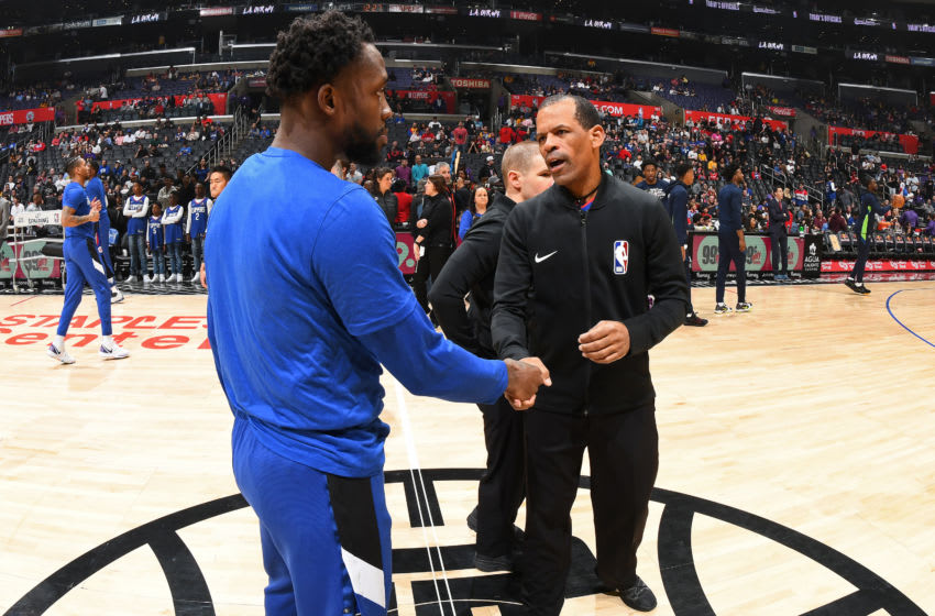 LOS ANGELES, CA - FEBRUARY 1: Patrick Beverley #21 of the LA Clippers shakes the hand of NBA Offical Eric Lewis before the game against the Minnesota Timberwolves on February 01, 2020 at STAPLES Center in Los Angeles, California. NOTE TO USER: User expressly acknowledges and agrees that, by downloading and/or using this Photograph, user is consenting to the terms and conditions of the Getty Images License Agreement. Mandatory Copyright Notice: Copyright 2020 NBAE (Photo by Adam Pantozzi/NBAE via Getty Images)