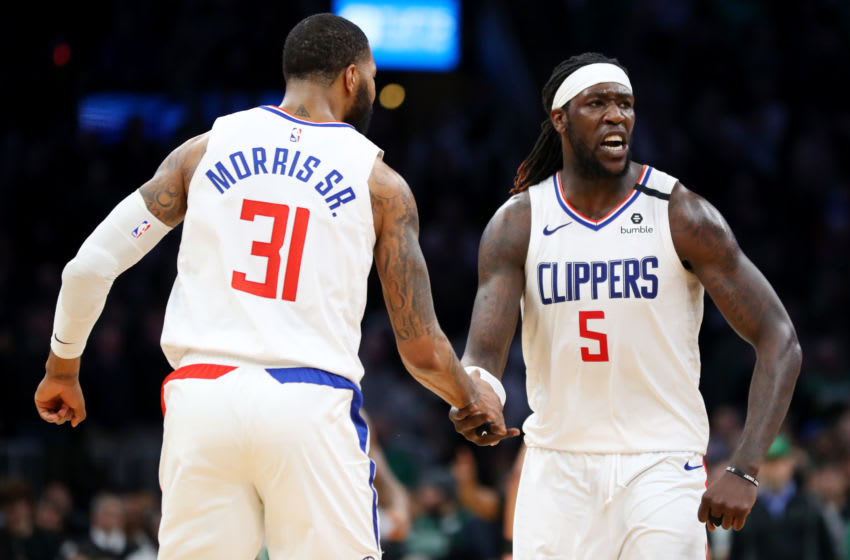 BOSTON, MASSACHUSETTS - FEBRUARY 13: Montrezl Harrell #5 of the LA Clippers celebrates with Marcus Morris Sr. #31 after scoring against the Boston Celtics at TD Garden on February 13, 2020 in Boston, Massachusetts. The Celtics defeat the Clippers in double overtime 141-133. (Photo by Maddie Meyer/Getty Images)