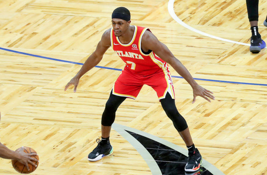 ORLANDO, FL - MARCH 03: Rajon Rondo #7 of the Atlanta Hawks plays defense against the Orlando Magic at Amway Center on March 3, 2021 in Orlando, Florida. NOTE TO USER: User expressly acknowledges and agrees that, by downloading and or using this photograph, User is consenting to the terms and conditions of the Getty Images License Agreement. (Photo by Alex Menendez/Getty Images)