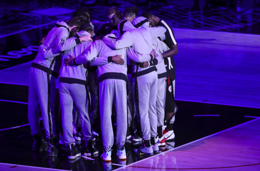 LOS ANGELES, CALIFORNIA - APRIL 01: The LA Clippers huddle ahead of the game against the Denver Nuggets at Staples Center on April 01, 2021 in Los Angeles, California. NOTE TO USER: User expressly acknowledges and agrees that, by downloading and or using this photograph, User is consenting to the terms and conditions of the Getty Images License Agreement. (Photo by Meg Oliphant/Getty Images)