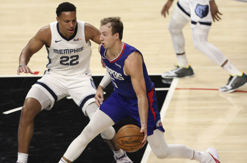 LOS ANGELES, CALIFORNIA - APRIL 21: Luke Kennard #5 of the LA Clippers handles the ball defended by Desmond Bane #22 of the Memphis Grizzlies at Staples Center on April 21, 2021 in Los Angeles, California. NOTE TO USER: User expressly acknowledges and agrees that, by downloading and or using this photograph, User is consenting to the terms and conditions of the Getty Images License Agreement. (Photo by Meg Oliphant/Getty Images)