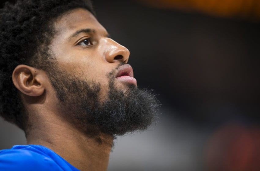 OKLAHOMA CITY, OK - APRIL 23: Paul George #13 of the Oklahoma City Thunder looks on before the game against the Utah Jazz in Game Four of Round One of the 2018 NBA Playoffs on April 23, 2018 NOTE TO USER: User expressly acknowledges and agrees that, by downloading and or using this photograph, User is consenting to the terms and conditions of the Getty Images License Agreement. Mandatory Copyright Notice: Copyright 2018 NBAE (Photo by Zach Beeker/NBAE via Getty Images)