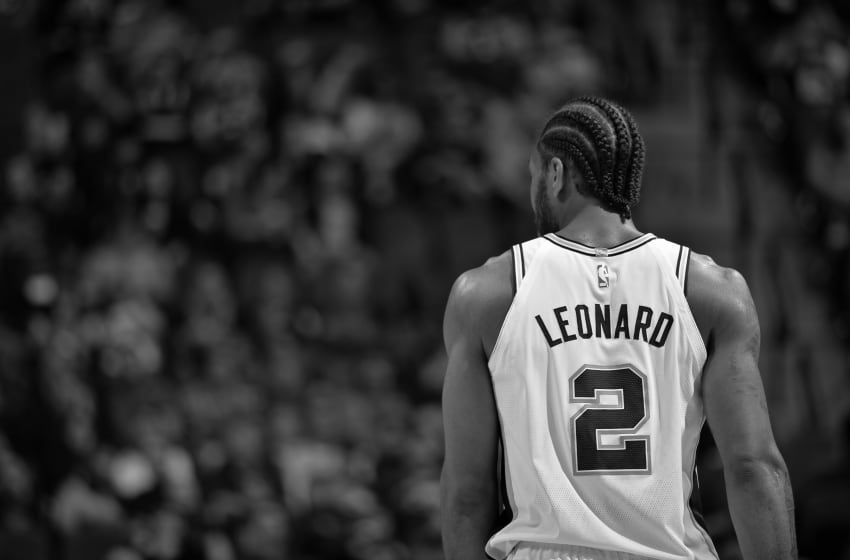 SAN ANTONIO, TX - DECEMBER 18:(EDITORS NOTE: Image has been converted to black and white.) A shot of Kawhi Leonard