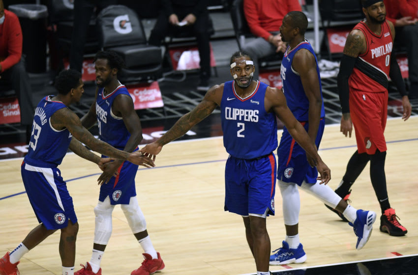 LOS ANGELES, CALIFORNIA - DECEMBER 30: Kawhi Leonard #2 of the LA Clippers celebrates and his basket with Lou Williams #23 and Patrick Beverley #21 during a 128-105 Clippers win at Staples Center on December 30, 2020 in Los Angeles, California. NOTE TO USER: User expressly acknowledges and agrees that, by downloading and/or using this photograph, user is consenting to the terms and conditions of the Getty Images License Agreement. (Photo by Harry How/Getty Images)