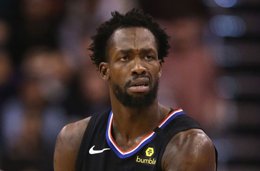 PHOENIX, ARIZONA - FEBRUARY 26: Patrick Beverley #21 of the LA Clippers reacts to a three point shot against the Phoenix Suns during the second half of the NBA game at Talking Stick Resort Arena on February 26, 2020 in Phoenix, Arizona. The Clippers defeated the Suns 102-92. NOTE TO USER: User expressly acknowledges and agrees that, by downloading and or using this photograph, user is consenting to the terms and conditions of the Getty Images License Agreement. Mandatory Copyright Notice: Copyright 2020 NBAE. (Photo by Christian Petersen/Getty Images)