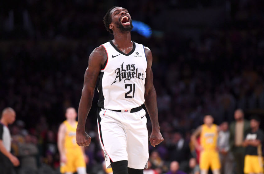 LOS ANGELES, CA - DECEMBER 25: Patrick Beverley #21 of the Los Angeles Clippers celebrates after he blocked a shot by LeBron James #23 of the Los Angeles Lakers in the second half of the game at Staples Center on December 25, 2019 in Los Angeles, California. NOTE TO USER: User expressly acknowledges and agrees that, by downloading and/or using this Photograph, user is consenting to the terms and conditions of the Getty Images License Agreement. (Photo by Jayne Kamin-Oncea/Getty Images)