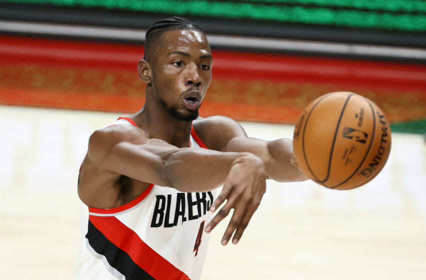 PORTLAND, OREGON - JANUARY 07: Harry Giles III #4 of the Portland Trail Blazers passes against the Minnesota Timberwolves during the fourth quarter at Moda Center on January 07, 2021 in Portland, Oregon. NOTE TO USER: User expressly acknowledges and agrees that, by downloading and or using this photograph, User is consenting to the terms and conditions of the Getty Images License Agreement. (Photo by Steph Chambers/Getty Images)