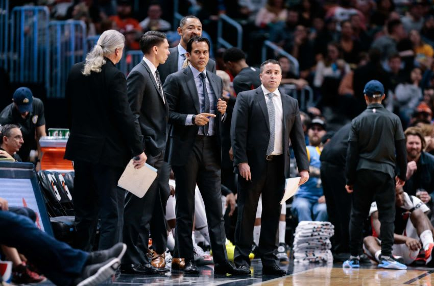 Nov 3, 2017; Denver, CO, USA; Miami Heat head coach Erik Spoelstra (C) with assistant coaches Chris Quinn (L) and Dan Craig (R) and Juwan Howard (behind) in the fourth quarter against the Denver Nuggets at the Pepsi Center. Mandatory Credit: Isaiah J. Downing-USA TODAY Sports