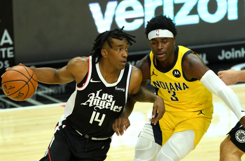 Jan 17, 2021; Los Angeles, California, USA; Indiana Pacers guard Aaron Holiday (3) guards Los Angeles Clippers guard Terance Mann (14) in the second half of the game at Staples Center. Mandatory Credit: Jayne Kamin-Oncea-USA TODAY Sports