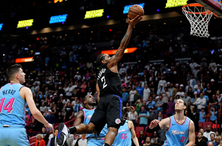 Jan 24, 2020; Miami, Florida, USA; LA Clippers forward Kawhi Leonard (2) shoots the ball around Miami Heat guard Dion Waiters (11) during the second half at American Airlines Arena. Mandatory Credit: Jasen Vinlove-USA TODAY Sports