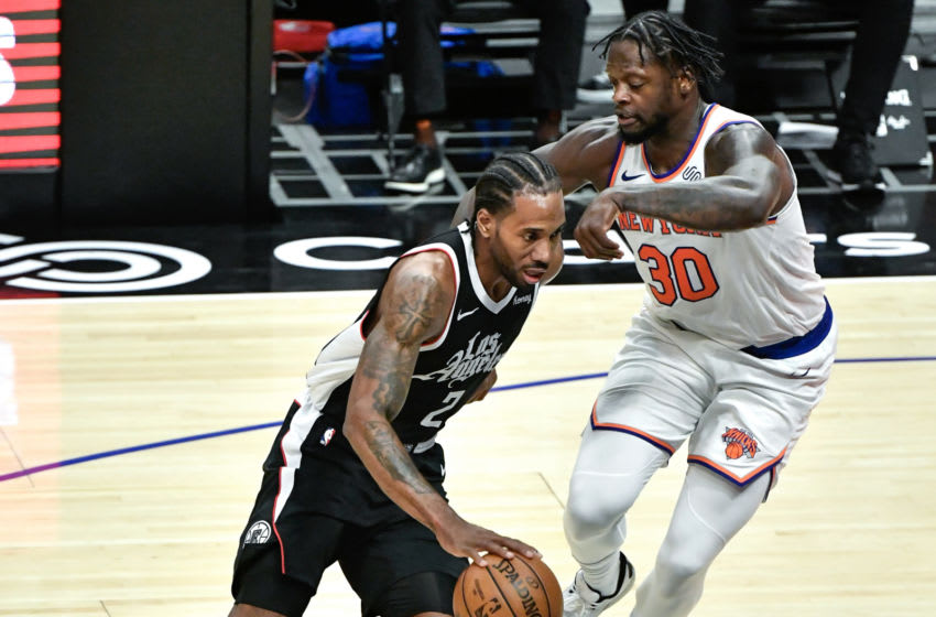 May 9, 2021; Los Angeles, California, USA; LA Clippers forward Kawhi Leonard (2) drives to the basket as New York Knicks forward Julius Randle (30) moves in to defend during the second half at Staples Center. Mandatory Credit: Robert Hanashiro-USA TODAY Sports
