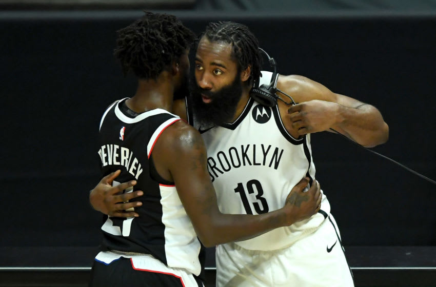 Feb 21, 2021; Los Angeles, California, USA; Los Angeles Clippers guard Patrick Beverley (21) and Brooklyn Nets guard James Harden (13) shake hands after the game. Mandatory Credit: Jayne Kamin-Oncea-USA TODAY Sports