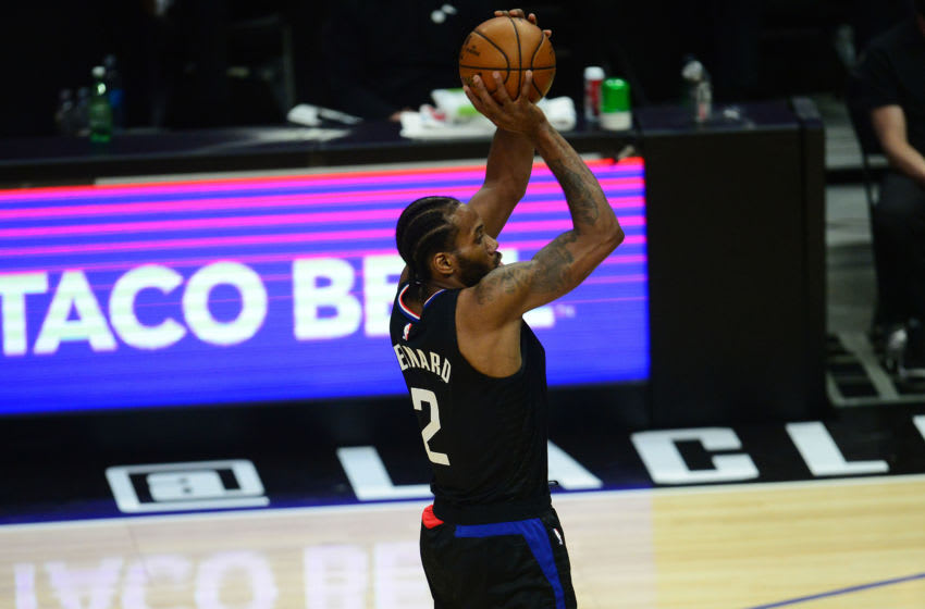 Jun 14, 2021; Los Angeles, California, USA; Los Angeles Clippers forward Kawhi Leonard (2) shoots against the Utah Jazz during the first half in game four in the second round of the 2021 NBA Playoffs. at Staples Center. Mandatory Credit: Gary A. Vasquez-USA TODAY Sports