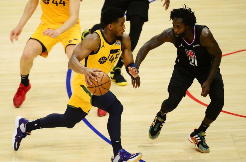 Jun 14, 2021; Los Angeles, California, USA; Utah Jazz guard Donovan Mitchell (45) moves the ball against Los Angeles Clippers guard Patrick Beverley (21) during the second half in game four in the second round of the 2021 NBA Playoffs. at Staples Center. Mandatory Credit: Gary A. Vasquez-USA TODAY Sports