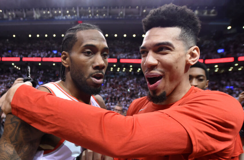 May 12, 2019; Toronto, Ontario, CAN; Toronto Raptors forward Kawhi Leonard (left) is greeted by guard Danny Green (right) after making the game winning basket to defeat Philadelphia 76ers in game seven of the second round of the 2019 NBA Playoffs at Scotiabank Arena. Mandatory Credit: Dan Hamilton-USA TODAY Sports