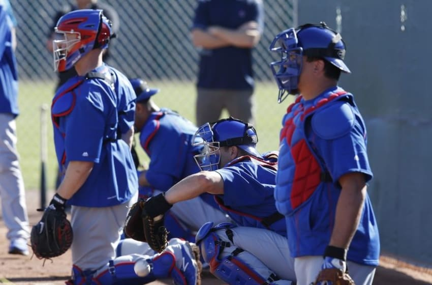 Feb 22, 2016; Mesa, AZ, USA; Chicago Cubs catchers work out in the bullpen during spring training camp at Sloan Park. Mandatory Credit: Rick Scuteri-USA TODAY Sports