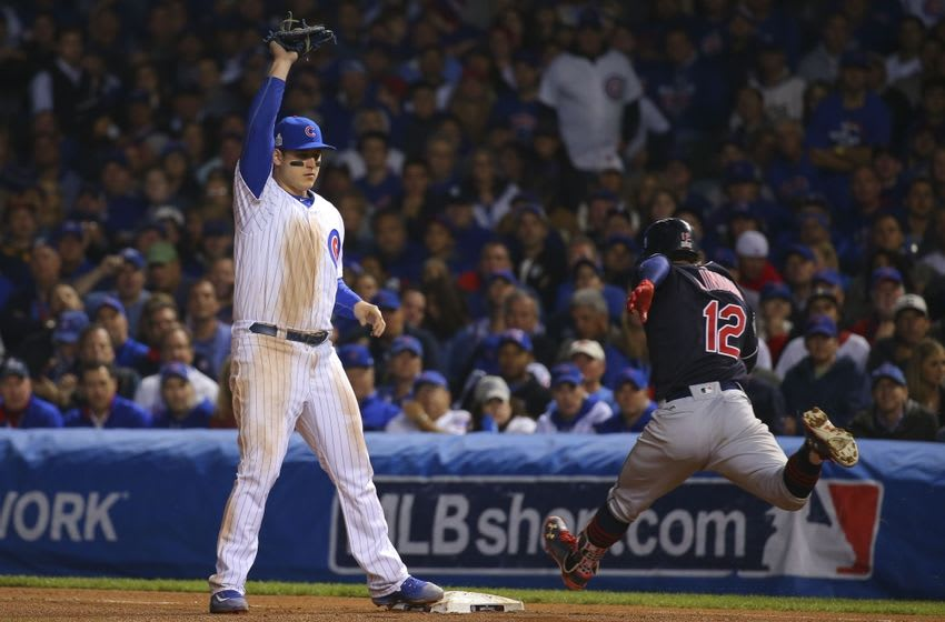 Oct 28, 2016; Chicago, IL, USA; Chicago Cubs first baseman Anthony Rizzo (left) catches the ball for an out against Cleveland Indians shortstop Francisco Lindor (12) during the eighth inning in game three of the 2016 World Series at Wrigley Field. Mandatory Credit: Dennis Wierzbicki-USA TODAY Sports