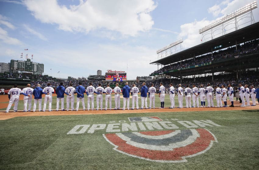 CHICAGO, IL - APRIL 10: Members of the Chicago Cubs stand during the National Anthem before the Opening Day home game against the Pittsburgh Pirates at Wrigley Field on April 10, 2018 in Chicago, Illinois. (Photo by Jonathan Daniel/Getty Images)