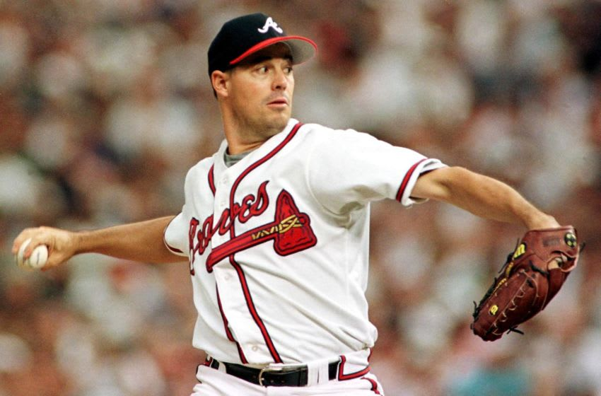 National League starting pitcher Greg Maddux of the Atlanta Braves winds up to pitch during the first inning of the1998 Major League All-Star game 07 July at Coors Field in Denver, Colorado. AFP PHOTO/Timothy A. CLARY (Photo by Timothy A. CLARY / AFP) (Photo credit should read TIMOTHY A. CLARY/AFP via Getty Images)