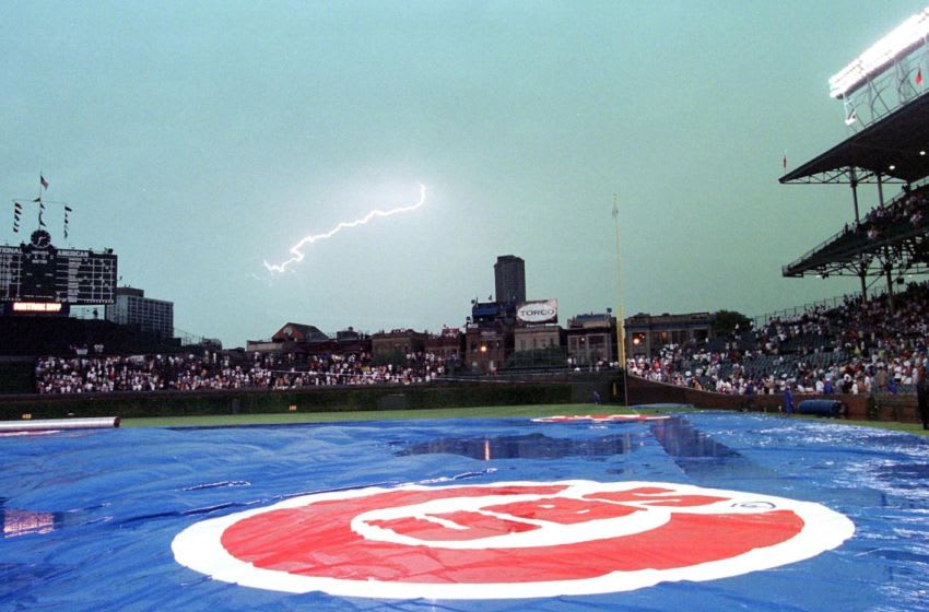 A tarp covers the field as rain and lightening delay the Houston Astros game against the Chicago Cubs at Wrigley Field 24 August in Chicago, IL. Despite the delay the Astros defeated the Cubs Chicago Cubs (Photo by DANIEL LIPPITT/AFP via Getty Images)