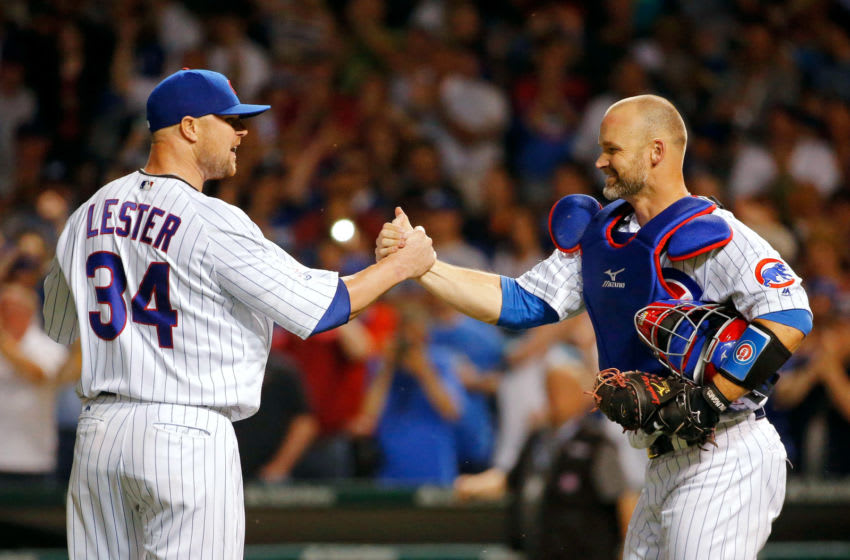 CHICAGO, IL - JUNE 01: David Ross #3 of the Chicago Cubs congratulates Jon Lester #34 for pitching a complete game for the win against the Los Angeles Dodgers at Wrigley Field on June 1, 2016 in Chicago, Illinois. The Chicago Cubs won 2-1. (Photo by Jon Durr/Getty Images)