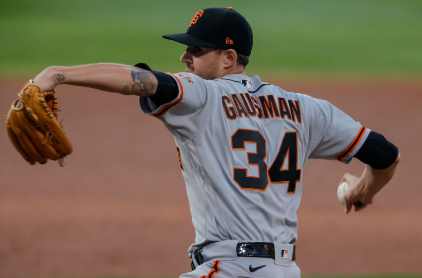 Sep 1, 2020; Denver, Colorado, USA; San Francisco Giants starting pitcher Kevin Gausman (34) pitches in the first inning against the Colorado Rockies at Coors Field. Mandatory Credit: Isaiah J. Downing-USA TODAY Sports