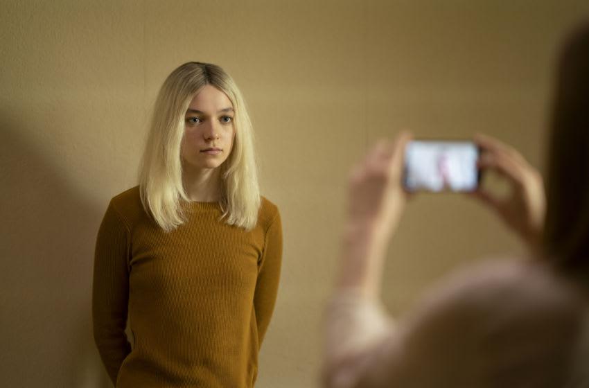 "Esmé Creed-Miles (orange shirt) as ""Hanna"" in HANNA Season Two on Amazon Prime Video. Image Courtesy Christopher Raphael/Amazon Prime Video"