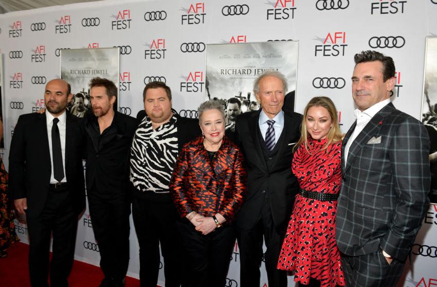HOLLYWOOD, CALIFORNIA - NOVEMBER 20: (L-R) Ian Gomez, Sam Rockwell, Paul Walter Hauser, Kathy Bates, Clint Eastwood, Blair Rich and Jon Hamm attend the