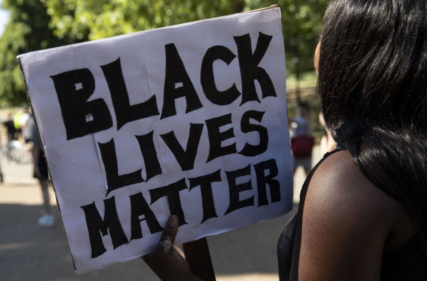 LONDON, ENGLAND - JUNE 01: Protesters take part in a 'Black Lives Matter' demonstration near Marble Arch on June 01, 2020 in London, England. The death of an African-American man, George Floyd, at the hands of police in Minneapolis has sparked violent protests across the USA. A video of the incident, taken by a bystander and posted on social media, showed Floyd's neck being pinned to the ground by police officer, Derek Chauvin, as he repeatedly said