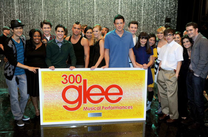 LOS ANGELES, CA - OCTOBER 26: The cast of GLEE poses with a large plaque listing all 300 songs they've performed at the